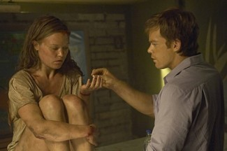 Julia Stiles and Michael C. Hall in 'Dexter' — Photo courtesy of Cliff Lipson / Showtime