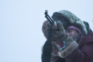 "Sue Aikens, star of 'Life Below Zero,' takes aim with her rifle in Kavik, Alaska — Photo courtesy of © 2012 BBC Worldwide Ltd. ""All Rights Reserved"""