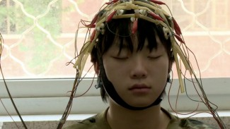 """Xi Wang (""""Hope"""") in 'Web Junkie', a film by Hilla Medalia and Shosh Shlam — Photo courtesy of Kino Lorber, Inc"""