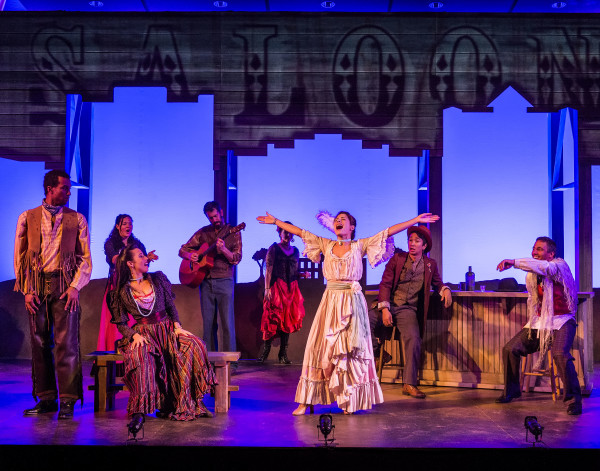 Off the Rails at the Autry has a cast that includes, from left, LeVance Tarver as Cowboy, Shyla Marlin (Choctaw) as Madame Overdone, Adrieanne Perez as Mariana, Román Zaragoza (Pima) as Alexie and Robert Vestal (Cherokee) as Pryor. The back row features, from left, Samantha Bowling (Cherokee/Algonquin) as Musician, Brian Joseph (Musical Director) and Kailey Erin Bray as Saloon Girl. Photo courtesy of Craig Schwartz © 2015
