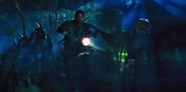 Owen (Chris Pratt) leads the raptors on a mission in Jurassic World. Photo courtesy of Universal Pictures and Amblin Entertainment