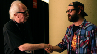 John Carpenter and Tal Zimerman meet in Why Horror? Photo courtesy of Don Ferguson Productions.