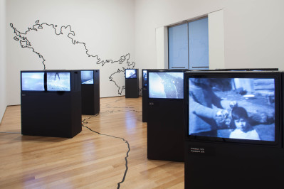 Juan Downey. Video Trans Americas. 1973-76. Fourteen-channel video (black and white, sound; duration variable) and vinyl map. Installation view, Transmissions: Art in Eastern Europe and Latin America, 1960–1980, The Museum of Modern Art, New York, September 5, 2015–January 3, 2016. The Museum of Modern Art, New York. Acquired through the generosity of the Latin American and Caribbean Fund and Baryn Futa in honor of Barbara London. © 2015 Estate of Juan Downey & Marilys B. Downey. Digital image © 2015 The Museum of Modern Art. Photo: Thomas Griesel