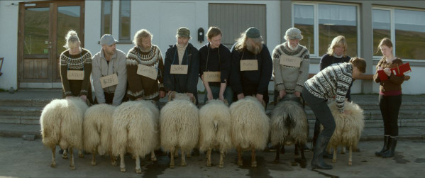 "Sigurður Sigurjónsson stars as ""Gummi"" (third from left), and Theodór Júlíusson stars as ""Kiddi"" (fourth from right) in Rams directed by Grímur Hákonarson. Photo courtesy of Cohen Media Group."