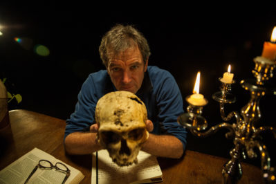 Dr. Mark Evans holds a skull on the TV special Yeti or Not. Photo courtesy of Animal Planet.