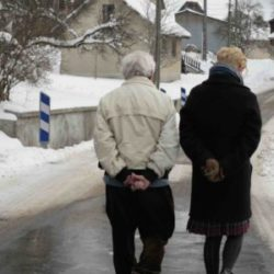 John Berger and Tilda Swinton walk down a street in the French Alps in The Seasons in Quincy: Four Portraits of John Berger. Photo courtesy of Sandro Kopp / Image courtesy Icarus Films.