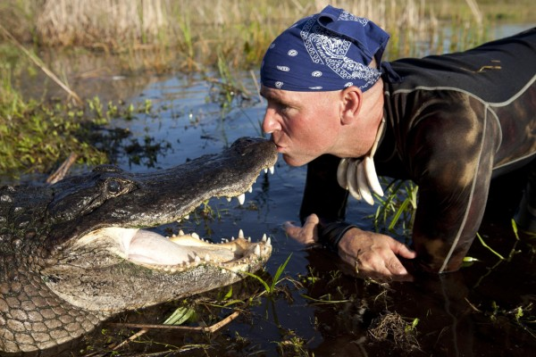 Paul Bedard kissing an alligator at Everglades Holiday Park — Photo courtesy of Animal Planet