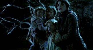Isabelle Nélisse, Megan Charpentier, Nikolaj Coster-Waldau and Jessica Chastain in 'Mama' — Photo courtesy of Universal Pictures