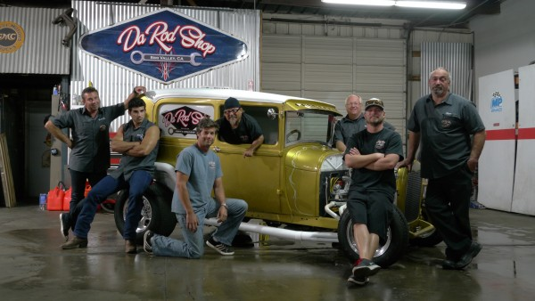 Billy Derian Sr., Billy Derian Jr., Jeff Thisted, Art Gil, Mike Dade, Shane Thisted and Steve Reck gather around the Model A for a candid group photo inside Da Rod Shop — Photo courtesy of Discovery Channel