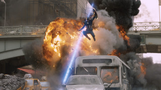 Captain America (Chris Evans) leaps from a fire in Avengers: Age of Ultron — Photo courtesy of Film Frame © 2011 MVLFFLLC.  TM & © 2011 Marvel.  All Rights Reserved.