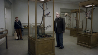 Per Bergqvist and Solveig Andersson star in A Pigeon Sat on a Branch Reflecting on Existence, a Magnolia Pictures release — Photo courtesy of Magnolia Pictures
