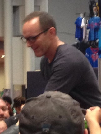 Clark Gregg, star of Agents of SHIELD, signs autographs at the Marvel booth. Photo by John Soltes.