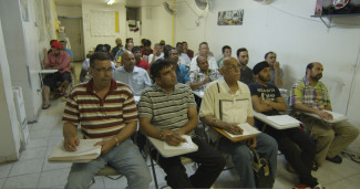 Taxi drivers attend a tutoring class in Frederick Wiseman's In Jackson Heights. Courtesy of Zipporah Films.
