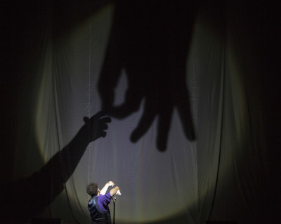 Raymond Crowe offers his show-stealing hand-shadow routine in The Illusionists. Photo courtesy of Joan Marcus.