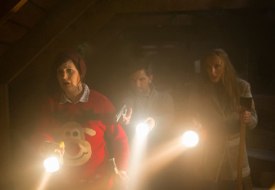 From left, Linda (Allison Tolman), Tom (Adam Scott) and Sarah (Toni Collette) need to find and kill Krampus in Legendary Pictures' Krampus, a darkly festive tale of a yuletide ghoul that reveals an irreverently twisted side to the holiday. Photo courtesy of Steve Unwin.