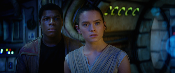 Star Wars: The Force Awakens stars, from left, John Boyega and Daisy Ridely. Photo courtesy of © 2014 Lucasfilm Ltd. & TM. All Right Reserved..
