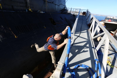 Rookie Dan Schoen jumps from submarine to dock on Deadliest Job Interview. Photo courtesy of Discovery Channel.