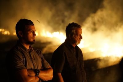 From left, Detective Aubrey St. Angelo and Retired Detective Rhodes Sanchez watch a sugar cane field burn on Killing Fields. Photo courtesy of Discovery Channel.