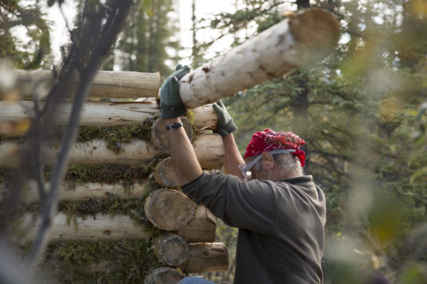 Heimo Korth works on his wood log cabin. Photo courtesy of Discovery Channel.